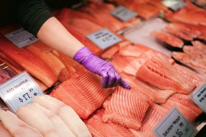 Picking out Fresh Salmon at The Market