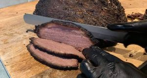 how to cut and slice brisket on a cutting board