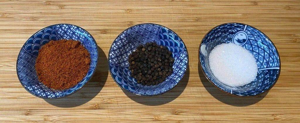 3 bowls with salt paprika for rub