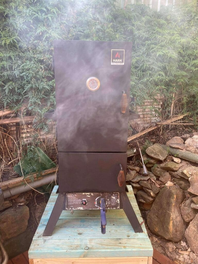 smoker in the backyard preheating for our cookout