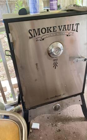 my smoke vault gas smoker on the patio