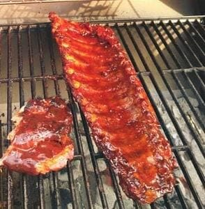 sweet and smoky grilled beef ribs on the grill