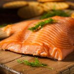 cold smoked salmon on a chopping board