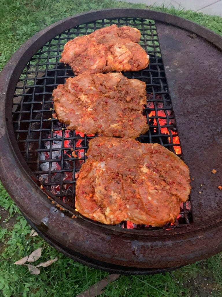 cooking chicken on the campfire at the camping grounds