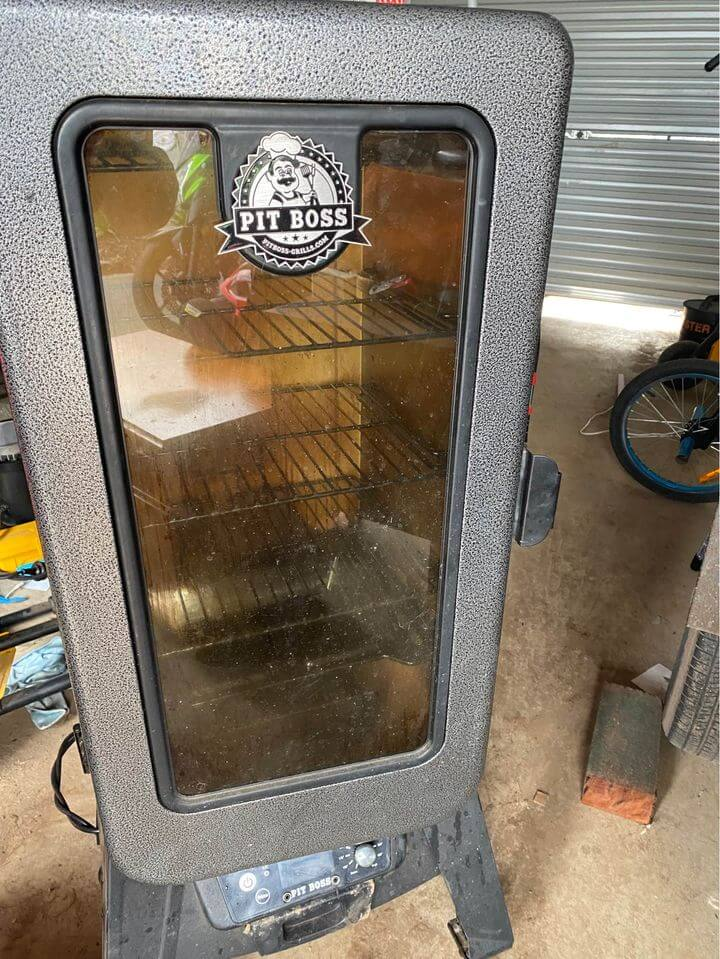 my pit boss vertical pellet smoker in the shed ready for the 4th july party