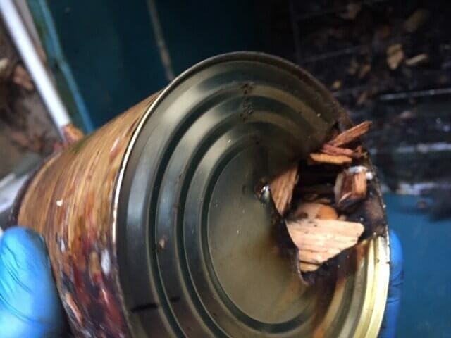Bottom of can, hole cut to shove in good old soldering iron