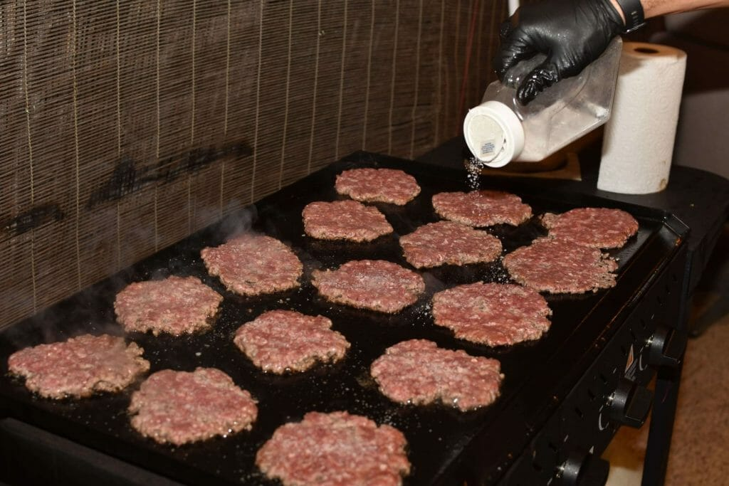 frozen burgers on grill